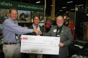 SCI President Larry Higgins (right) presents the check to Myles McCallum (left) and Buzz Charlton (center).